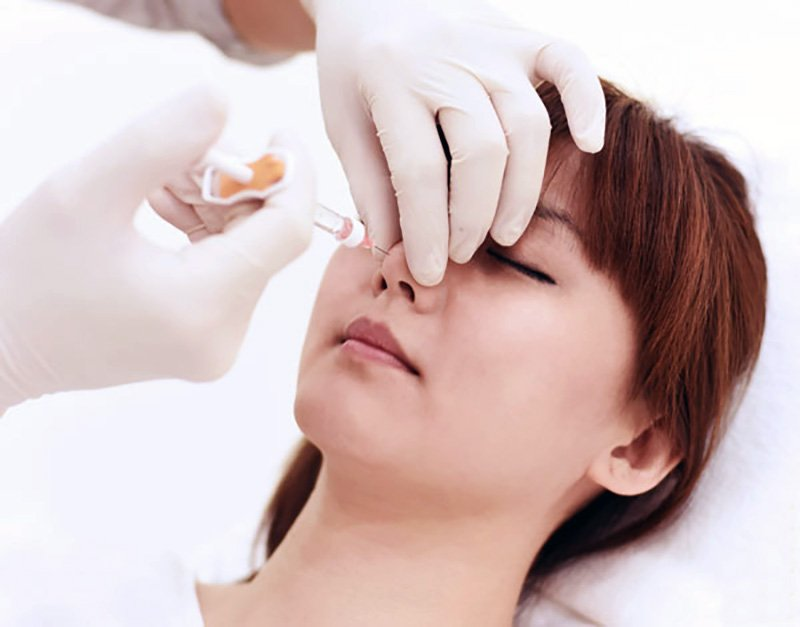 Woman Having Nose Fillers Injection