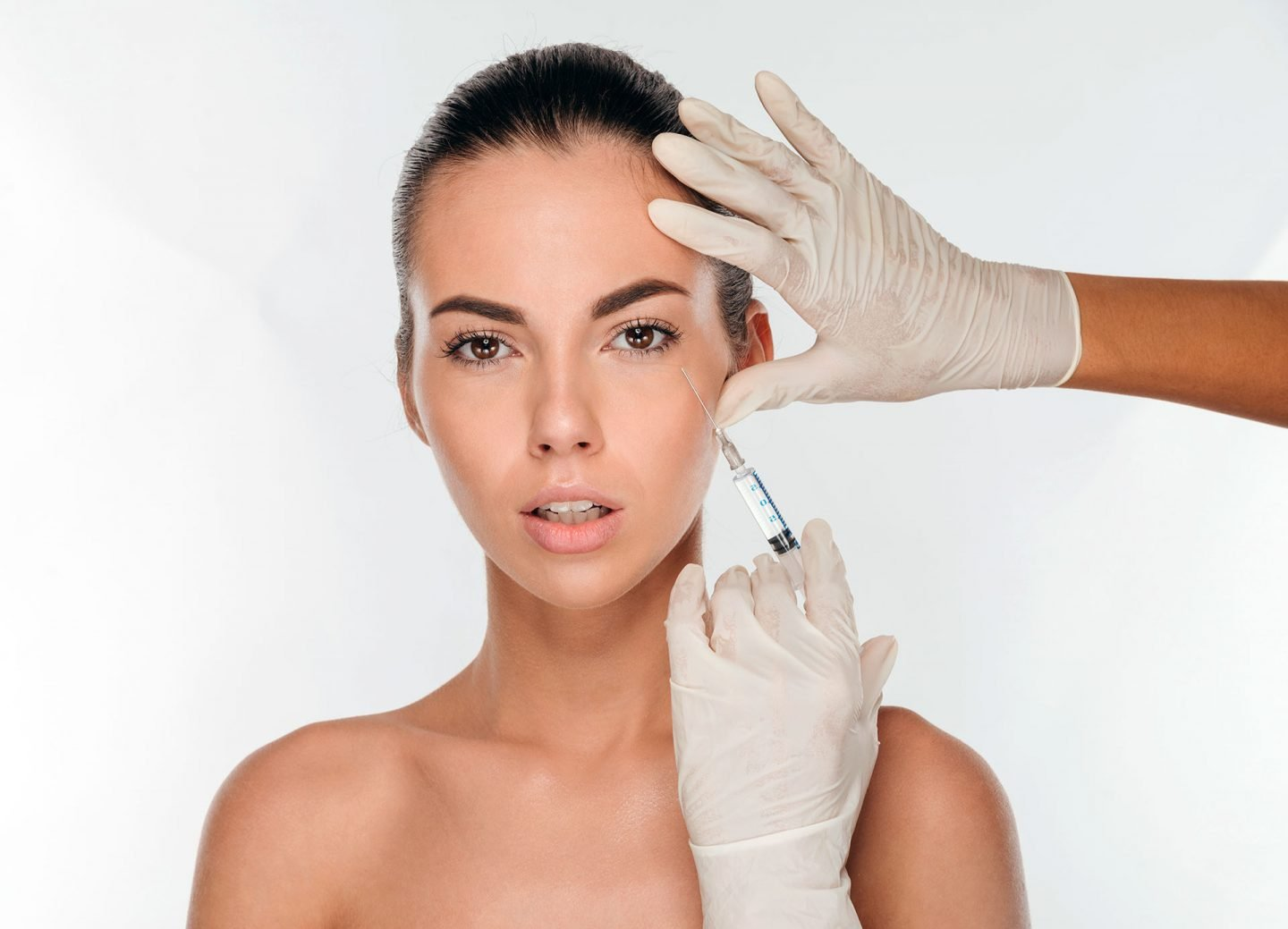 Woman receives a dermal filler injection