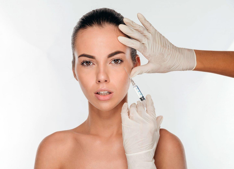 Woman receives a dermal filler injection