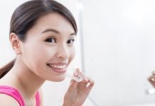 asian girl is holding MBrace aligners